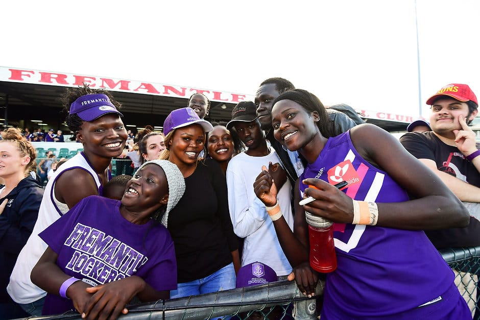 PERTH, AUSTRALIA - FEBRUARY 12: Akec Makur Chuot of the Dockers is embraced by family during the 2017 AFLW Round 02 match between the Fremantle Dockers and the Brisbane Lions at Fremantle Oval on February 12, 2017 in Perth, Australia. (Photo by Daniel Carson/AFL Media)