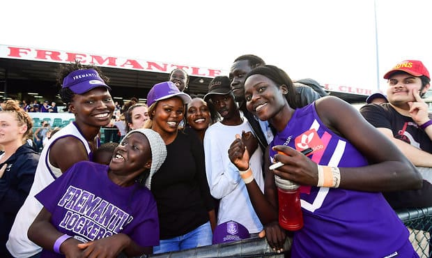 Akec Chuot with her family after an AFLW game at Fremantle Oval.