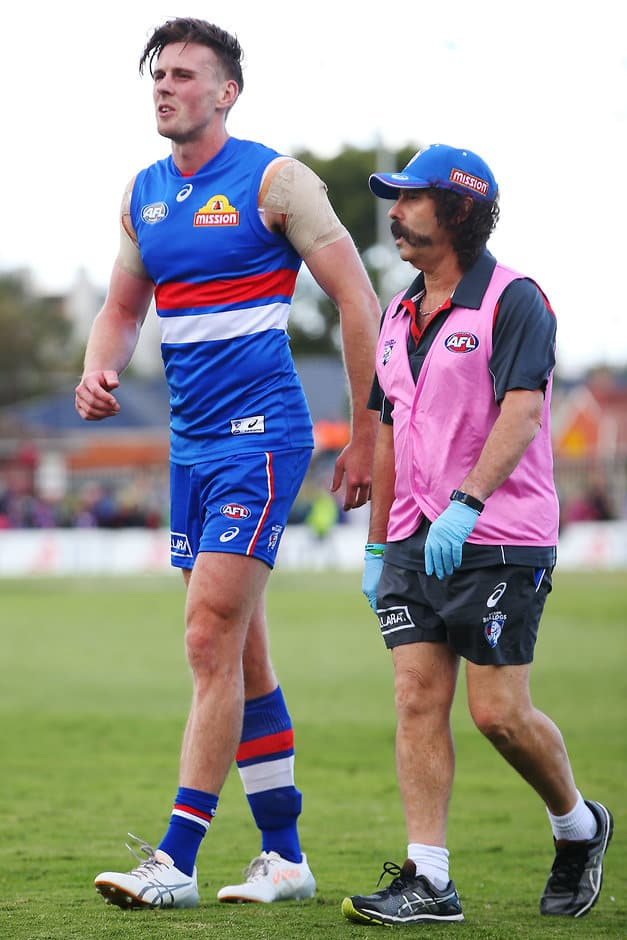 MELBOURNE, AUSTRALIA - FEBRUARY 18: Jordan Roughead of the Bulldogs hobbles off after sustaining a leg injury during the AFL 2017JLT Community Series match between the Western Bulldogs and the Melbourne Demons at VU Whitten Oval on February 18, 2017 in Melbourne, Australia. (Photo by Michael Dodge/AFL Media)