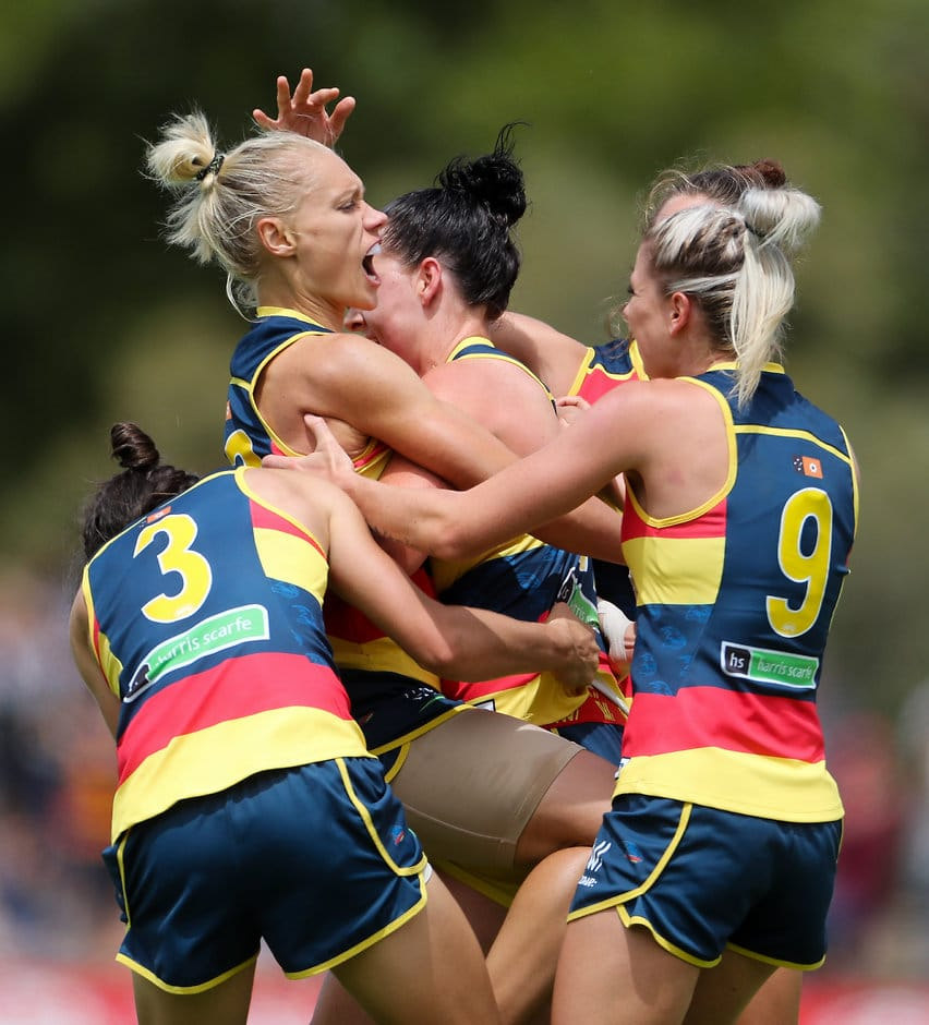 ADELAIDE, AUSTRALIA - FEBRUARY 19: Erin Phillips of the Crows celebrates a goal with team mates during the 2017 AFLW Round 03 match between the Adelaide Crows and the Carlton Blues at Thebarton Oval on February 19, 2017 in Adelaide, Australia. (Photo by AFL Media)