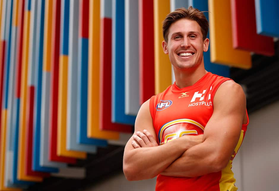 GOLD COAST, AUSTRALIA - FEBRUARY 23: David Swallow of the Suns poses for a portrait during the Gold Coast Suns team photo day at Metricon Stadium on February 23, 2017 in Gold Coast, Australia. (Photo by Adam Trafford/AFL Media)