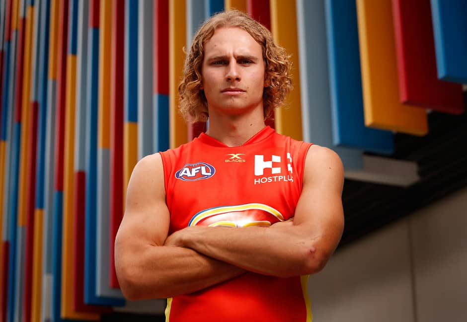 GOLD COAST, AUSTRALIA - FEBRUARY 23: Will Brodie of the Suns poses for a portrait during the Gold Coast Suns team photo day at Metricon Stadium on February 23, 2017 in Gold Coast, Australia. (Photo by Adam Trafford/AFL Media)