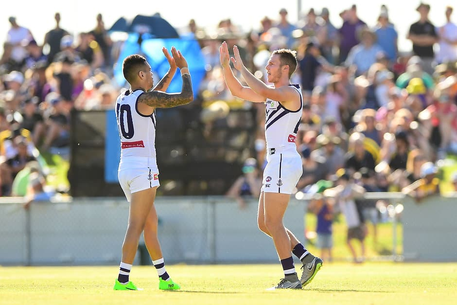 GERALDTON, AUSTRALIA - FEBRUARY 25: Ed Langdon of the Dockers celebrates a goal with Michael Walters of the Dockers during the AFL 2017 JLT Community Series match between the West Coast Eagles and the Fremantle Dockers at Wonthella Oval on February 25, 2017 in Geraldton, Australia. (Photo by Daniel Carson/AFL Media)