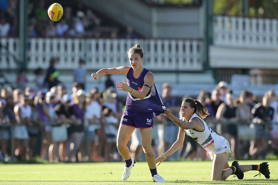 PERTH, AUSTRALIA - FEBRUARY 26: Ebony Antonio of the Dockers handballs under pressure from Chelsea Randall of the Crows during the 2017 AFLW Round 04 match between the Fremantle Dockers and the Adelaide Crows at Fremantle Oval on February 26, 2017 in Perth, Australia. (Photo by Will Russell/AFL Media)