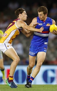 MELBOURNE, AUSTRALIA - MARCH 2: Dale Morris of the Bulldogs is tackled by Jacob Allison of the Lions during the AFL 2017 JLT Community Series match between the Western Bulldogs and the Brisbane Lions at Etihad Stadium on March 2, 2017 in Melbourne, Australia. (Photo by Michael Willson/AFL Media) - Western Bulldogs,Dale Morris
