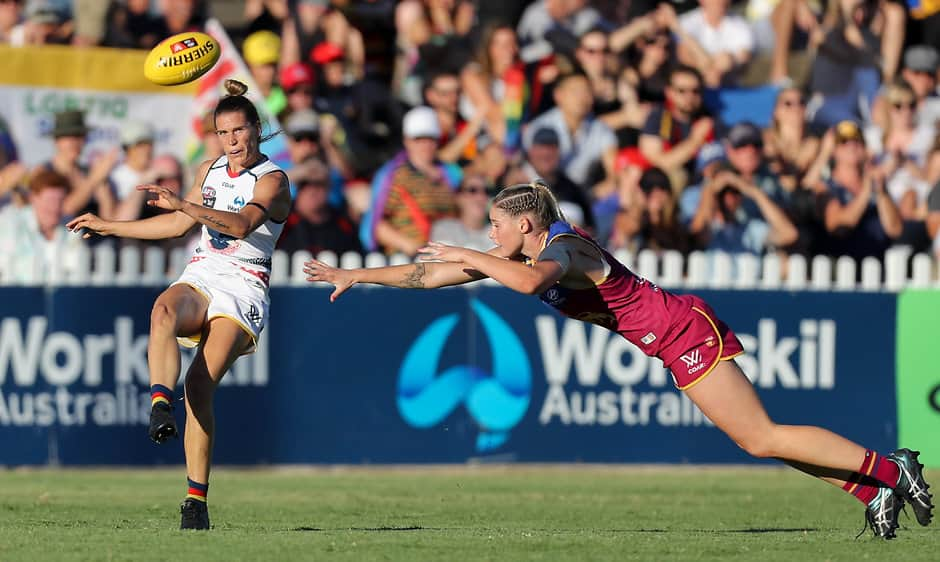 ADELAIDE, AUSTRALIA - MARCH 4: Chelsea Randall of the Crows kicks the ball past a diving Tayla Harris of the Lions during the 2017 AFLW Round 05 match between the Adelaide Crows and the Brisbane Lions at Norwood Oval on March 4, 2017 in Adelaide, Australia. (Photo by AFL Media)