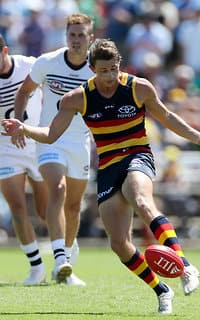 ADELAIDE, AUSTRALIA - MARCH 5: Matt Crouch of the Crows kicks during the AFL 2017 JLT Community Series match between the Adelaide Crows and the Geelong Cats at Richmond Oval on March 5, 2017 in Adelaide, Australia. (Photo by AFL Media)