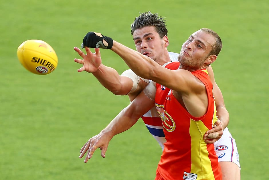 GOLD COAST, AUSTRALIA - MARCH 09:  Tom Boyd of the Bulldogs and Jarrod Witts of the Suns compete for the ball during the JLTR Community Series AFL match between the Gold Coast Suns and the Western Bulldogs at Metricon Stadium on March 9, 2017 in Gold Coast, Australia.  (Photo by Chris Hyde/Getty Images)