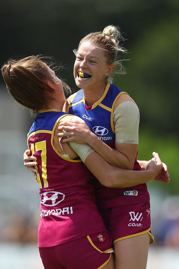 BRISBANE, AUSTRALIA - MARCH 11:  Kate McCarthy of the Lions celebrates a goal during the round six AFL Women's match between the Brisbane Lions and the Western Bulldogs at South Pine Sports Complex on March 11, 2017 in Brisbane, Australia.  (Photo by Chris Hyde/AFL Media/Getty Images)