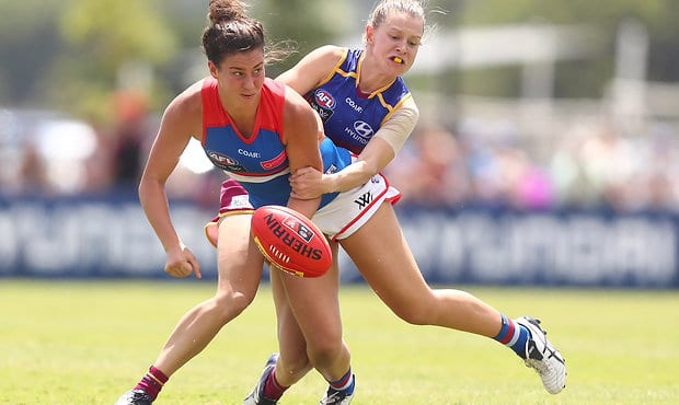 BRISBANE, AUSTRALIA - MARCH 11:  Libby Birch of the Bulldogs is tackled during the round six AFL Women's match between the Brisbane Lions and the Western Bulldogs at South Pine Sports Complex on March 11, 2017 in Brisbane, Australia.  (Photo by Chris Hyde/AFL Media/Getty Images) - Western Bulldogs,AFLW