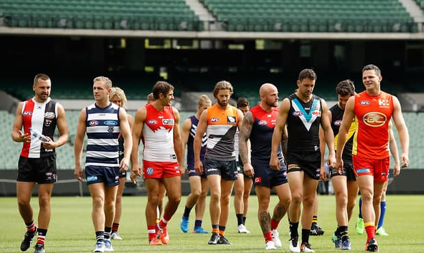 MELBOURNE, AUSTRALIA - MARCH 16: The captains walk towards the press conference during the AFL Captains Day at the Melbourne Cricket Ground on March 16, 2017 in Melbourne, Australia. (Photo by Adam Trafford/AFL Media)