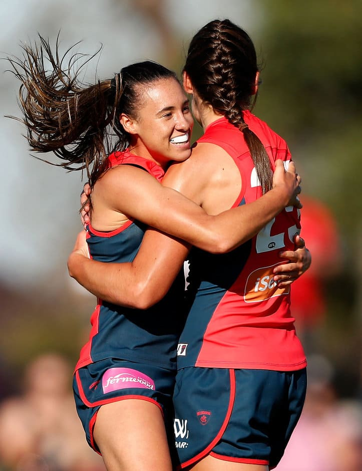 MELBOURNE, AUSTRALIA - MARCH 18: Aliesha Newman of the Demons (left) celebrates a goal with Madeleine Boyd of the Demons during the 2017 AFLW Round 07 match between the Melbourne Demons and the Fremantle Dockers at Casey Fields on March 18, 2017 in Melbourne, Australia. (Photo by Adam Trafford/AFL Media)