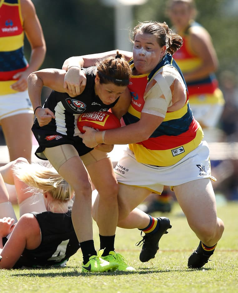 MELBOURNE, AUSTRALIA - MARCH 19: Bree White of the Magpies is tackled by Sarah Perkins of the Crows during the 2017 AFLW Round 07 match between the Collingwood Magpies and the Adelaide Crows at Olympic Park Oval on March 19, 2017 in Melbourne, Australia. (Photo by Michael Willson/AFL Media)