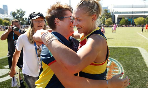 MELBOURNE, AUSTRALIA - MARCH 19: Bec Goddard, Senior Coach of the Crows and Erin Phillips of the Crows celebrate during the 2017 AFLW Round 07 match between the Collingwood Magpies and the Adelaide Crows at Olympic Park Oval on March 19, 2017 in Melbourne, Australia. (Photo by Michael Willson/AFL Media)