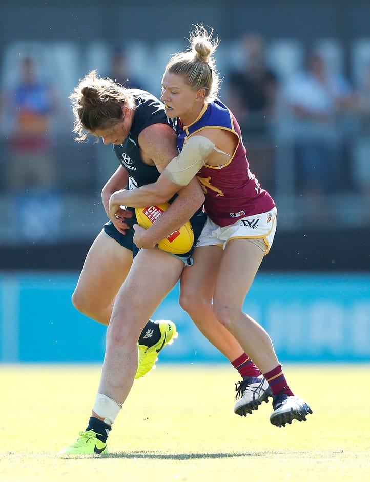 MELBOURNE, AUSTRALIA - MARCH 19: Brianna Davey of the Blues is tackled by Kate McCarthy of the Lions during the 2017 AFLW Round 07 match between the Carlton Blues and the Brisbane Lions at Ikon Park on March 19, 2017 in Melbourne, Australia. (Photo by Adam Trafford/AFL Media)