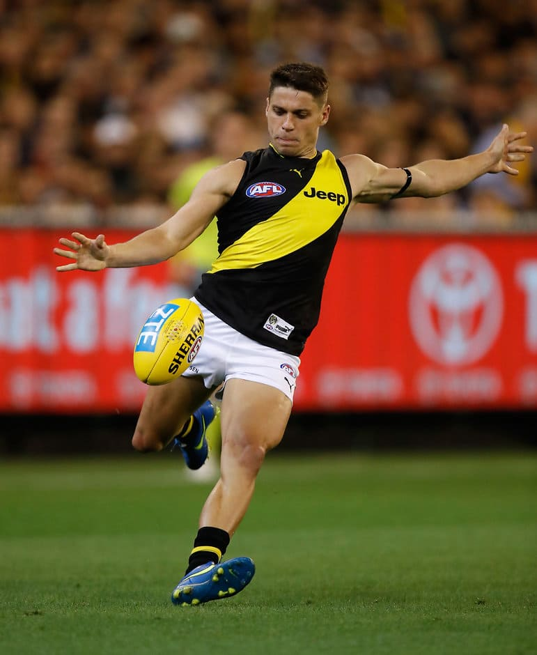 MELBOURNE, AUSTRALIA - MARCH 23: Dion Prestia of the Tigers kicks the ball during the 2017 AFL round 01 match between the Carlton Blues and the Richmond Tigers at the Melbourne Cricket Ground on March 23, 2017 in Melbourne, Australia. (Photo by Michael Willson/AFL Media)