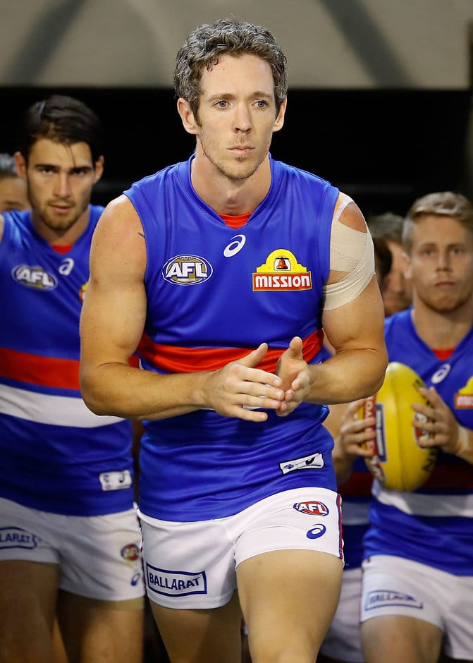 Bob Murphy was back to lead the premiers against Collingwood - ${keywords}