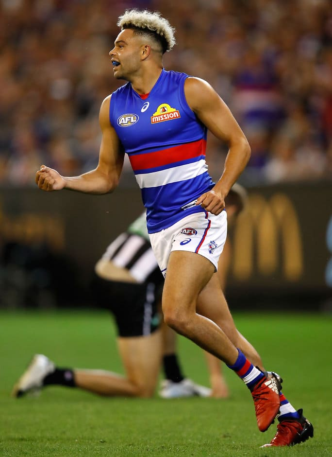 MELBOURNE, AUSTRALIA - MARCH 24: Jason Johannisen of the Bulldogs celebrates a goal during the 2017 AFL round 01 match between the Collingwood Magpies and the Western Bulldogs at the Melbourne Cricket Ground on March 24, 2017 in Melbourne, Australia. (Photo by Michael Willson/AFL Media)