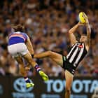 MELBOURNE, AUSTRALIA - MARCH 24: Jeremy Howe of the Magpies marks over Marcus Bontempelli of the Bulldogs during the 2017 AFL round 01 match between the Collingwood Magpies and the Western Bulldogs at the Melbourne Cricket Ground on March 24, 2017 in Melbourne, Australia. (Photo by Michael Willson/AFL Media)