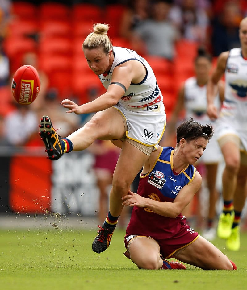 GOLD COAST, AUSTRALIA - MARCH 25: Courtney Cramey of the Crows is tackled by Samantha Virgo of the Lions during the 2017 AFLW Grand Final match between the Brisbane Lions and the Adelaide Crows at Metricon Stadium on March 25, 2017 in Gold Coast, Australia. (Photo by Michael Willson/AFL Media)