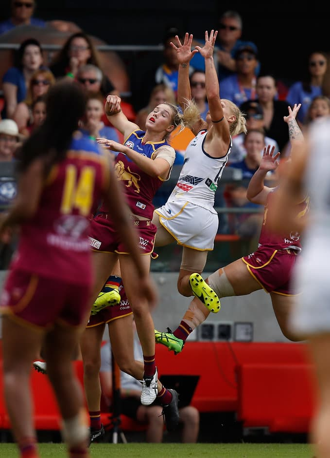GOLD COAST, AUSTRALIA - MARCH 25: Erin Phillips of the Crows takes a spectacular mark over Tayla Harris of the Lions during the 2017 AFLW Grand Final match between the Brisbane Lions and the Adelaide Crows at Metricon Stadium on March 25, 2017 in Gold Coast, Australia. (Photo by Michael Willson/AFL Media)