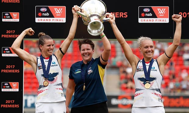 GOLD COAST, AUSTRALIA - MARCH 25: (L-R) Chelsea Randall, Bec Goddard (Coach) and Erin Phillips of the Crows hold the cup aloft after winning the inaugural AFLW Premiership during the 2017 AFLW Grand Final match between the Brisbane Lions and the Adelaide Crows at Metricon Stadium on March 25, 2017 in Gold Coast, Australia. (Photo by Michael Willson/AFL Media)