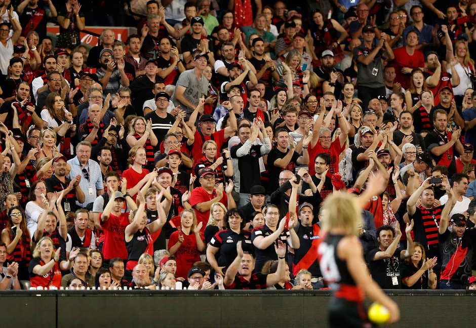 MELBOURNE, AUSTRALIA - MARCH 25: Bombers fans cheer as new captain Dyson Heppell of the Bombers takes possession of the ball before the siren during the 2017 AFL round 01 match between the Essendon Bombers and the Hawthorn Hawks at the Melbourne Cricket Ground on March 25, 2017 in Melbourne, Australia. (Photo by Adam Trafford/AFL Media)