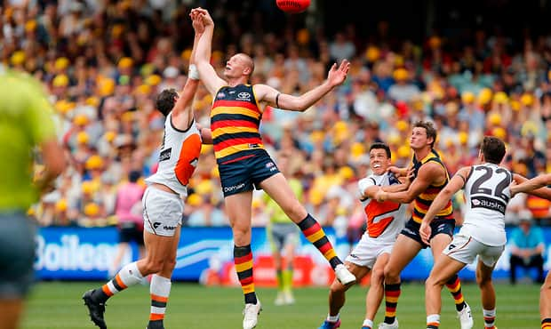 ADELAIDE, AUSTRALIA - MARCH 26: Shane Mumford of the Giants competes with Sam Jacobs, Adelaide Crows during the 2017 AFL round 01 match between the Adelaide Crows and the GWS Giants at Adelaide Oval on March 26, 2017 in Adelaide, Australia. (Photo by James Elsby/AFL Media)