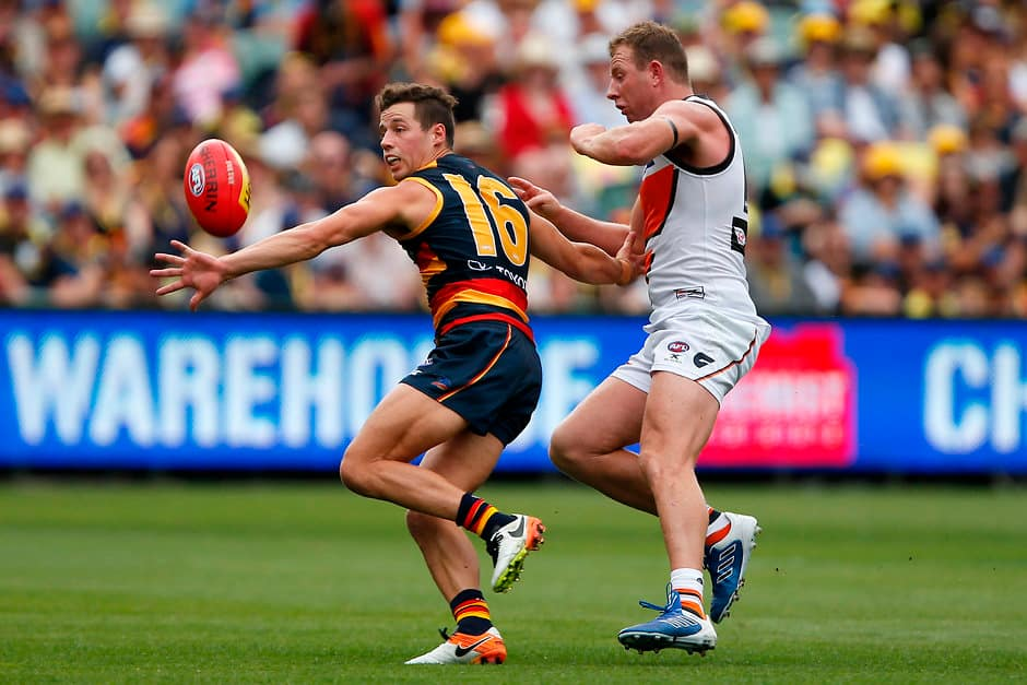 ADELAIDE, AUSTRALIA - MARCH 26: Luke Brown of the Crows is tackled by Steve Johnson of the Giants during the 2017 AFL round 01 match between the Adelaide Crows and the GWS Giants at Adelaide Oval on March 26, 2017 in Adelaide, Australia. (Photo by James Elsby/AFL Media)