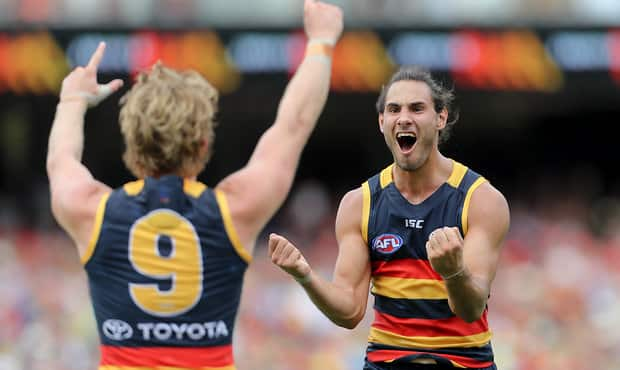 \ADELAIDE, AUSTRALIA - MARCH 26: Troy Menzel of the Crows celebrates a goal with team mate Rory Sloane during the 2017 AFL round 01 match between the Adelaide Crows and the GWS Giants at Adelaide Oval on March 26, 2017 in Adelaide, Australia. (Photo by AFL Media)