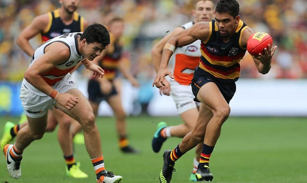 ADELAIDE, AUSTRALIA - MARCH 26: Charlie Cameron of the Crows breaks away from Matthew Kennedy of the Giants during the 2017 AFL round 01 match between the Adelaide Crows and the GWS Giants at Adelaide Oval on March 26, 2017 in Adelaide, Australia. (Photo by AFL Media)