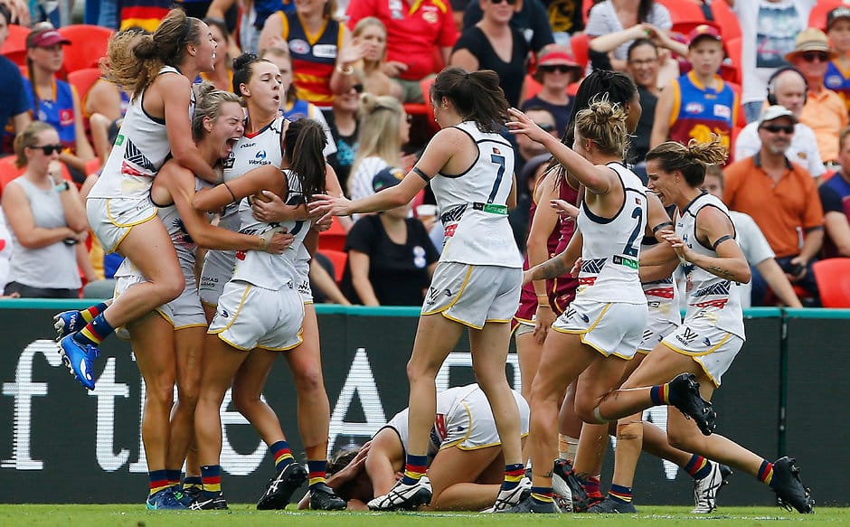 GOLD COAST, AUSTRALIA - MARCH 25:  Crows players celebrate at the final whistle   during the AFL Women's Grand Final between the Brisbane Lions and the Adelaide Crows on March 25, 2017 in Gold Coast, Australia.  (Photo by Jason O'Brien/Getty Images)