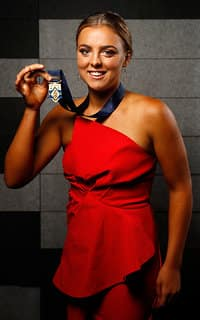 MELBOURNE, AUSTRALIA - MARCH 28: Ebony Marinoff of the Crows poses for a photograph with her Rising Star medal during the The W Awards at the Peninsula on March 28, 2017 in Melbourne, Australia. (Photo by Adam Trafford/AFL Media)