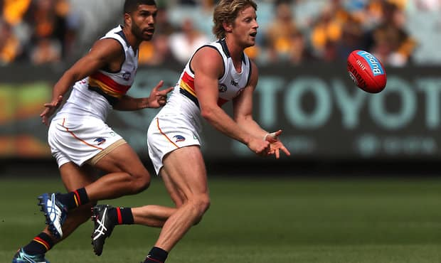 MELBOURNE, AUSTRALIA - APRIL 01: Rory Sloane of the Crows handballs during the 2017 AFL round 02 match between the Hawthorn Hawks and the Adelaide Crows at the Melbourne Cricket Ground on April 01, 2017 in Melbourne, Australia. (Photo by Sean Garnsworthy/AFL Media)
