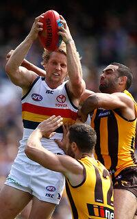 MELBOURNE, AUSTRALIA - APRIL 01: Rory Sloane of the Crows marks the ball ahead of Shaun Burgoyne of the Hawks during the 2017 AFL round 02 match between the Hawthorn Hawks and the Adelaide Crows at the Melbourne Cricket Ground on April 01, 2017 in Melbourne, Australia. (Photo by Michael Willson/AFL Media)