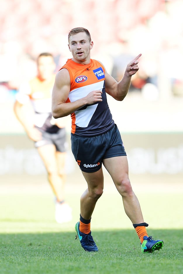 SYDNEY, AUSTRALIA - APRIL 01: Devon Smith of the Giants celebrates kicking a goal during the round two AFL match between the Greater Western Sydney Giants and the Gold Coast Suns at Spotless Stadium on April 1, 2017 in Sydney, Australia.  (Photo by Brett Hemmings/AFL Media/Getty Images)