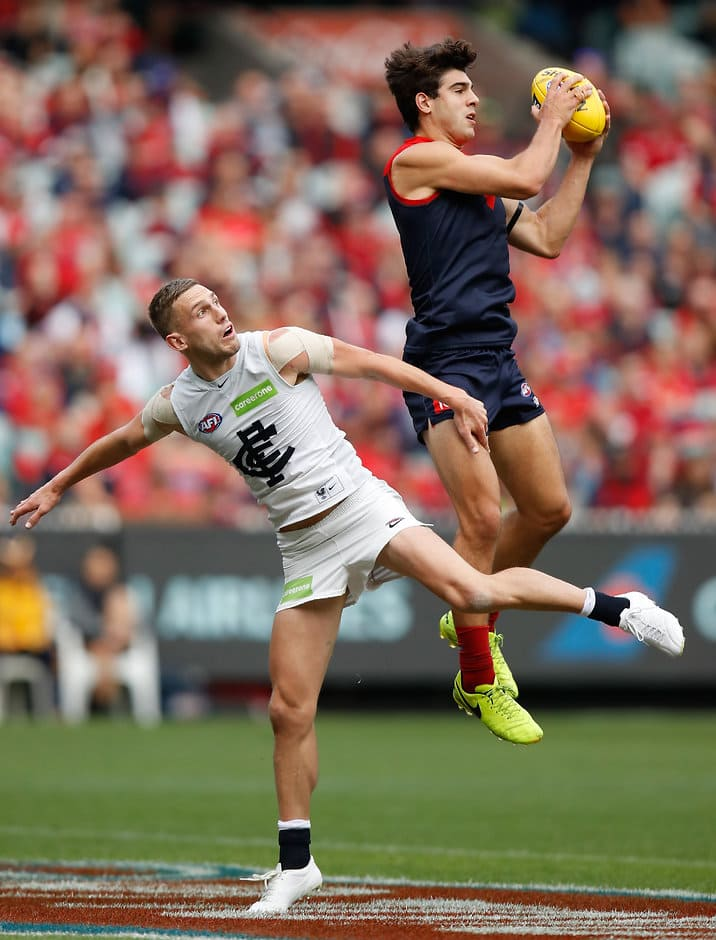 MELBOURNE, AUSTRALIA - APRIL 02: Christian Salem of the Demons marks over Billie Smedts of the Blues during the 2017 AFL round 02 match between the Melbourne Demons and the Carlton Blues at the Melbourne Cricket Ground on April 02, 2017 in Melbourne, Australia. (Photo by Michael Willson/AFL Media)