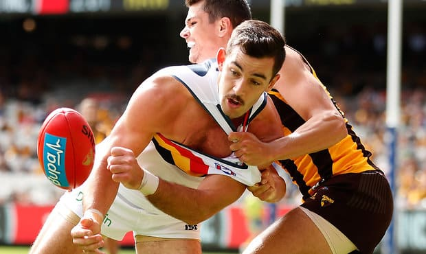 MELBOURNE, AUSTRALIA - APRIL 01: Taylor Walker of the Crows and Ryan Burton of the Hawks compete for the ball during the 2017 AFL round 02 match between the Hawthorn Hawks and the Adelaide Crows at the Melbourne Cricket Ground on April 01, 2017 in Melbourne, Australia. (Photo by Michael Willson/AFL Media)
