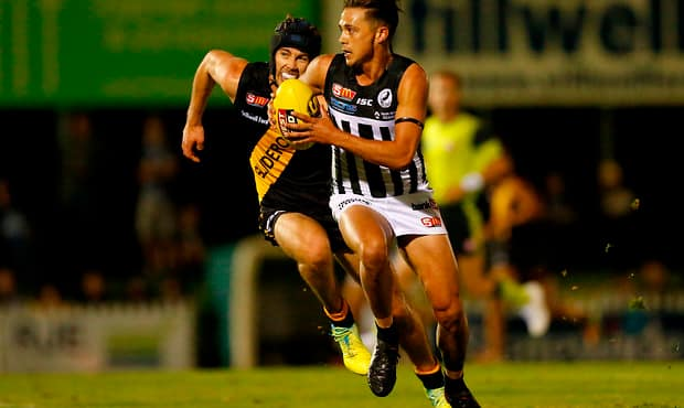 ADELAIDE, AUSTRALIA - APRIL 07: Christopher Curran of the Tigers competes with Aidyn Johnson of the Magpies during the 2017 SANFL round 01 match between Glenelg and Port Adelaide at Gliderol Stadium on April 07, 2017 in Adelaide, Australia. (Photo by James Elsby/AFL Media)
