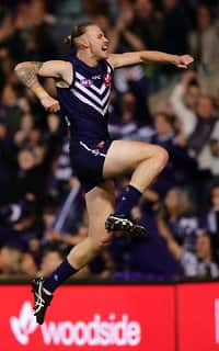 Cam McCarthy celebrates one of his goals against the Dogs