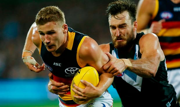 The Crows and Power collide at Adelaide Oval on Sunday afternoon in Showdown XLIII