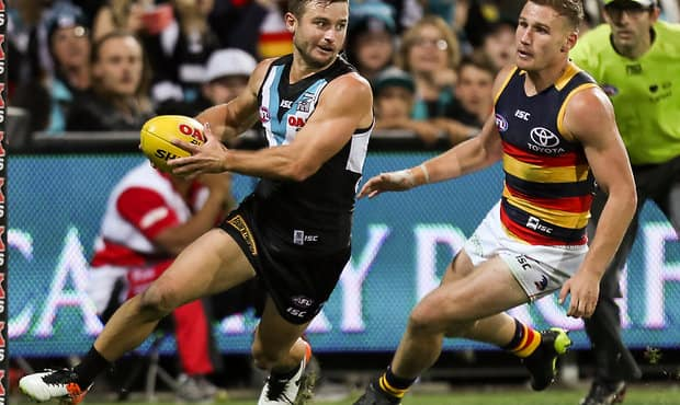 ADELAIDE, AUSTRALIA - APRIL 08: Sam Gray of the Power evades Rory Laird of the Crows during the 2017 AFL round 03 match between Port Adelaide Power and the Adelaide Crows at the Adelaide Oval on April 08, 2017 in Adelaide, Australia. (Photo by AFL Media)