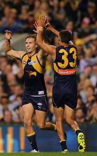 Mark LeCras and Josh Hill celebrate after a goal