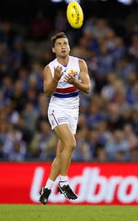 MELBOURNE, AUSTRALIA - APRIL 14: Luke Dahlhaus of the Bulldogs marks the ball during the 2017 AFL round 04 match between the North Melbourne Kangaroos and the Western Bulldogs at Etihad Stadium on April 14, 2017 in Melbourne, Australia. (Photo by Adam Trafford/AFL Media)