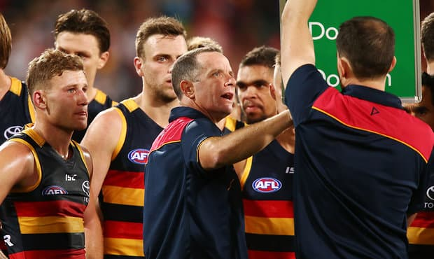 ADELAIDE, AUSTRALIA - APRIL 15:  Crows head coach Don Pyke speaks to his team during the round four AFL match between the Adelaide Crows and the Essendon Bombers at Adelaide Oval on April 15, 2017 in Adelaide, Australia.  (Photo by Morne de Klerk/Getty Images/AFL Media)