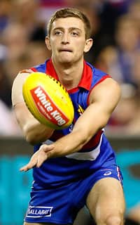 MELBOURNE, AUSTRALIA - APRIL 22: Fletcher Roberts of the Bulldogs handpasses the ball \during the 2017 AFL round 05 match between the Western Bulldogs and the Brisbane Lions at Etihad Stadium on April 22, 2017 in Melbourne, Australia. (Photo by Adam Trafford/AFL Media) - Fletcher Roberts,Western Bulldogs