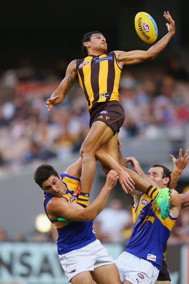 MELBOURNE, AUSTRALIA - APRIL 23:  Cyril Rioli of the Hawks compete for the ball over Tom Barrass of the Eagles (L) and Shannon Hurn of the Eagles during the round five AFL match between the Hawthorn Hawks and the West Coast Eagles at Melbourne Cricket Ground on April 23, 2017 in Melbourne, Australia.  (Photo by Michael Dodge/Getty Images/AFL Media)