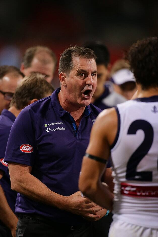 PERTH, AUSTRALIA - APRIL 29: Ross Lyon, Senior Coach of the Dockers, addresses the players at the quarter time break during the 2017 AFL round 06 match between the West Coast Eagles and the Fremantle Dockers at Domain Stadium on April 29, 2017 in Perth, Australia. (Photo by Will Russell/AFL Media)
