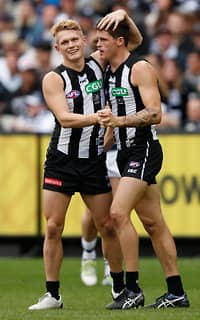Adam Treloar and Jack Crisp celebrate a goal