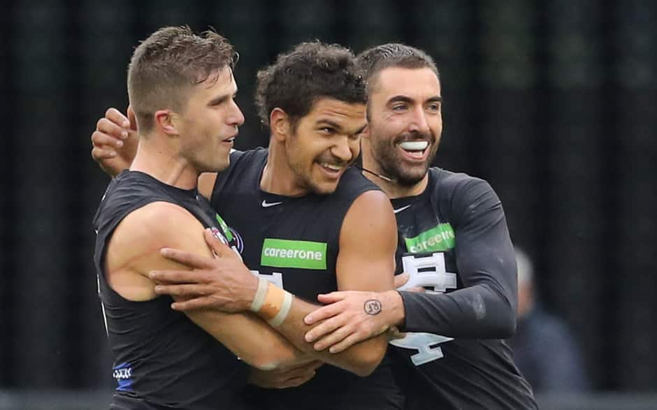 MELBOURNE, AUSTRALIA - MAY 06:  Sam Petrevski-Seton of the Blues is congratulated by Marc Murphy of the Blues and Kade Simpson of the Blues kicking a goal  during the 2017 AFL round 07 match between the Collingwood Magpies and the Carlton Blues at the Melbourne Cricket Ground on May 06, 2017 in Melbourne, Australia. (Photo by Scott Barbour/AFL Media)